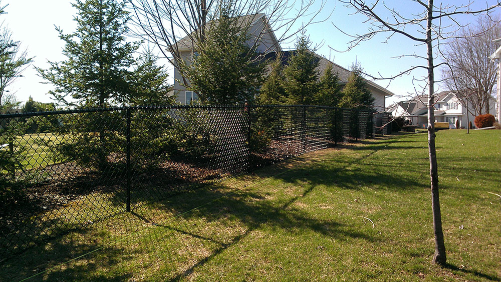 professional fence builders, chain link dumpster enclosure, construction fence posts, installing steel fencing, full privacy wood fence, when is the best time to install a fence, mitfence.com, mi t fence company greenville wi, mit fence fox valley, mit fence wisconsin,